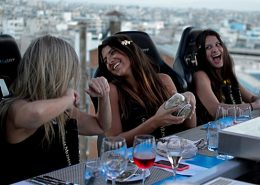 Girls having fun dinner in the sky greece